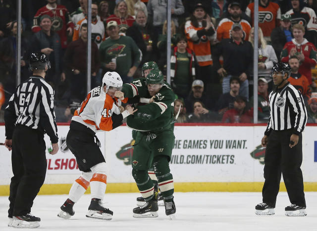 Minnesota Wild's Marcus Foligno fights Philadelphia Flyers' Joel Farabee in the second period of an NHL hockey game Saturday Dec. 14, 2019, in St. Paul, Minn. (AP Photo/Stacy Bengs)