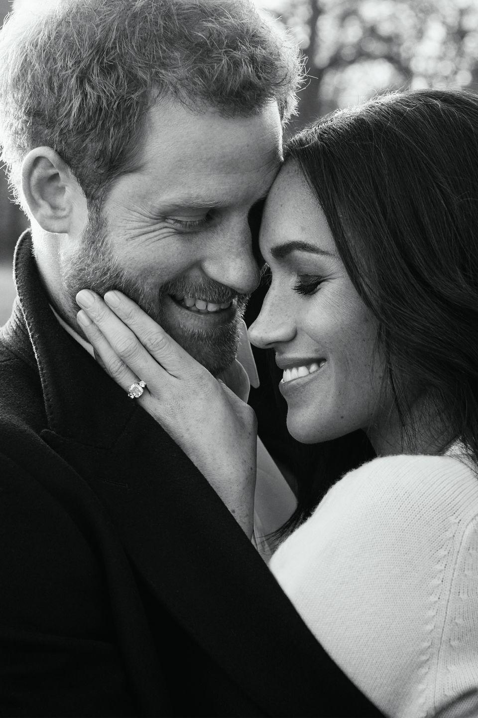 <p>Meghan's engagement ring is visible in this portrait of the newly engaged couple.</p>