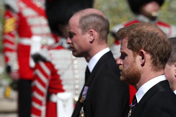 Image: Princes William and Harry follow the Land Rover Defender carrying Prince Philip's coffin at Windsor Castle. (Gareth Fuller / AFP - Getty Images)
