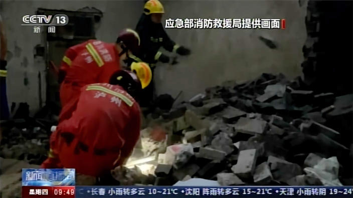 In this image made from video run by China's CCTV, rescuers search for survivors at a damaged house following an earthquake in Luxian County, southwest China's Sichuan Province, Thursday, Sept. 16, 2021. Rescue work was underway following the magnitude-6.0 earthquake.(CCTV via AP)
