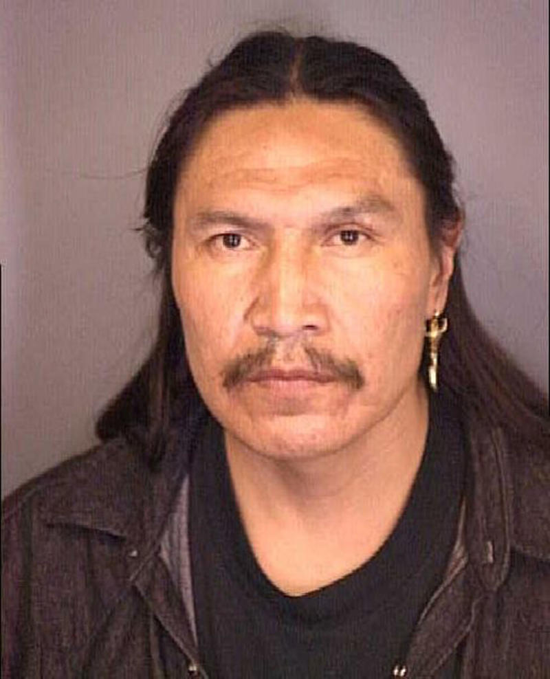 FILE - This 1998 file photo provided by the Denver Police Department shows Arlo Looking Cloud.  Looking Cloud, convicted in 2004 of first-degree murder for his role in the 1975 shooting death of an American Indian Movement activist, has had his federal prison sentence reduced from life to 20 years, federal court documents show. (AP Photo/Denver Police Department, File)