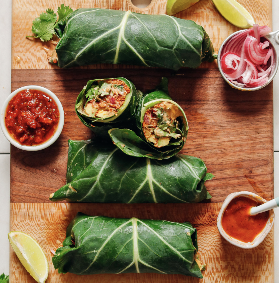 """<p>These beautiful burritos only take 30 minutes to make. Stuffed with vegan meat and cheese alternatives and wrapped up tightly in a collard green leaf, this burrito will turn the head of anyone you invite over <em>and </em>anyone scrolling through your IG feed. <br><br><a class=""""link rapid-noclick-resp"""" href=""""https://minimalistbaker.com/vegan-collard-green-burritos/#wprm-recipe-container-34116"""" rel=""""nofollow noopener"""" target=""""_blank"""" data-ylk=""""slk:Get the recipe"""">Get the recipe</a><br><em><br>Per one burrito: 555 cal, 46.3 g fat (5.6 g saturated fat), 28.7 g carbs, 9.4 g sugar, 574.1 mg sodium, 8.3 g fiber, 14.8 g protein</em></p>"""