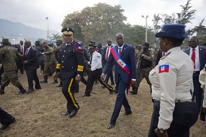 Haiti's President Jovenel Moise walks with Police chief Michel-Ange Gedeon past National Police at the National Palace after being sworn-in at Parliament in Port-au-Prince, Haiti, Tuesday Feb. 7, 2017. Moise was sworn as president for the next five years after a bruising two-year election cycle, inheriting a struggling economy and a deeply divided society. (AP Photo/Dieu Nalio Chery)