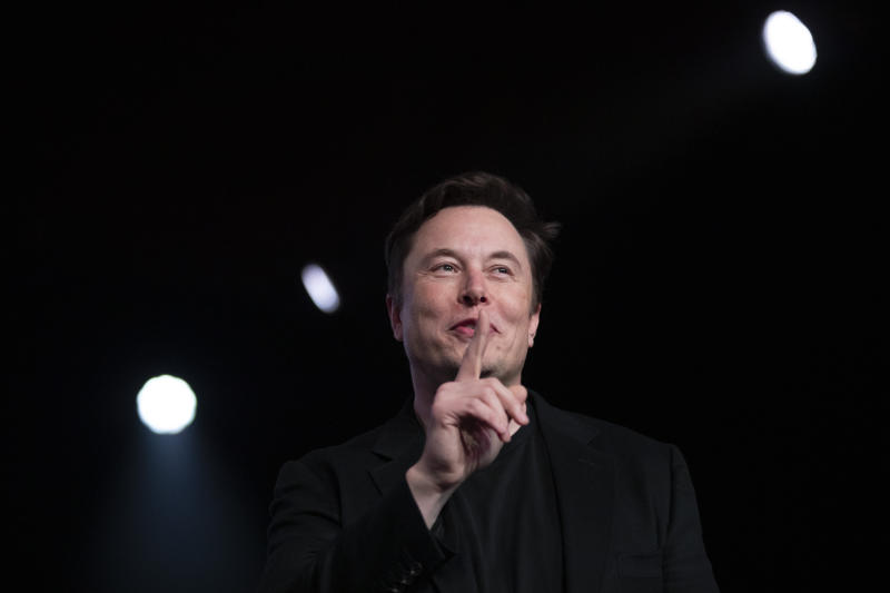 FILE- In this March 14, 2019, file photo Tesla CEO Elon Musk speaks before unveiling the Model Y at Tesla's design studio in Hawthorne, Calif. Musk is taking on the workhorse heavy pickup truck market with his latest electric vehicle. The CEO of Tesla will unveil a new electric pickup truck at the Los Angeles Auto Show Thursday, Nov. 21, 2019. (AP Photo/Jae C. Hong, File)