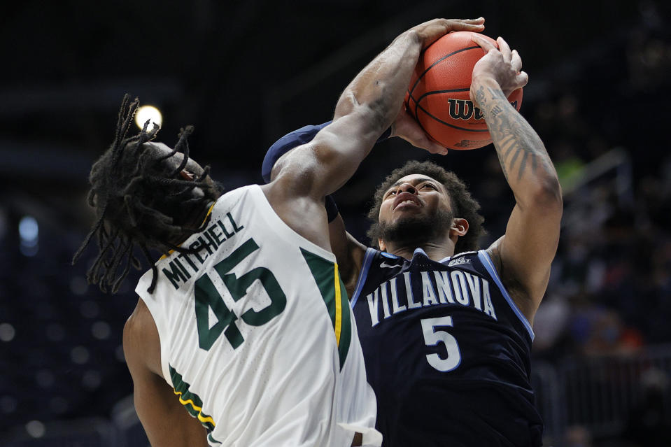 INDIANAPOLIS, INDIANA - MARCH 27: Davion Mitchell #45 of the Baylor Bears blocks a shot by Justin Moore #5 of the Villanova Wildcats in the second half of their Sweet Sixteen game of the 2021 NCAA Men's Basketball Tournament at Hinkle Fieldhouse on March 27, 2021 in Indianapolis, Indiana. (Photo by Sarah Stier/Getty Images)