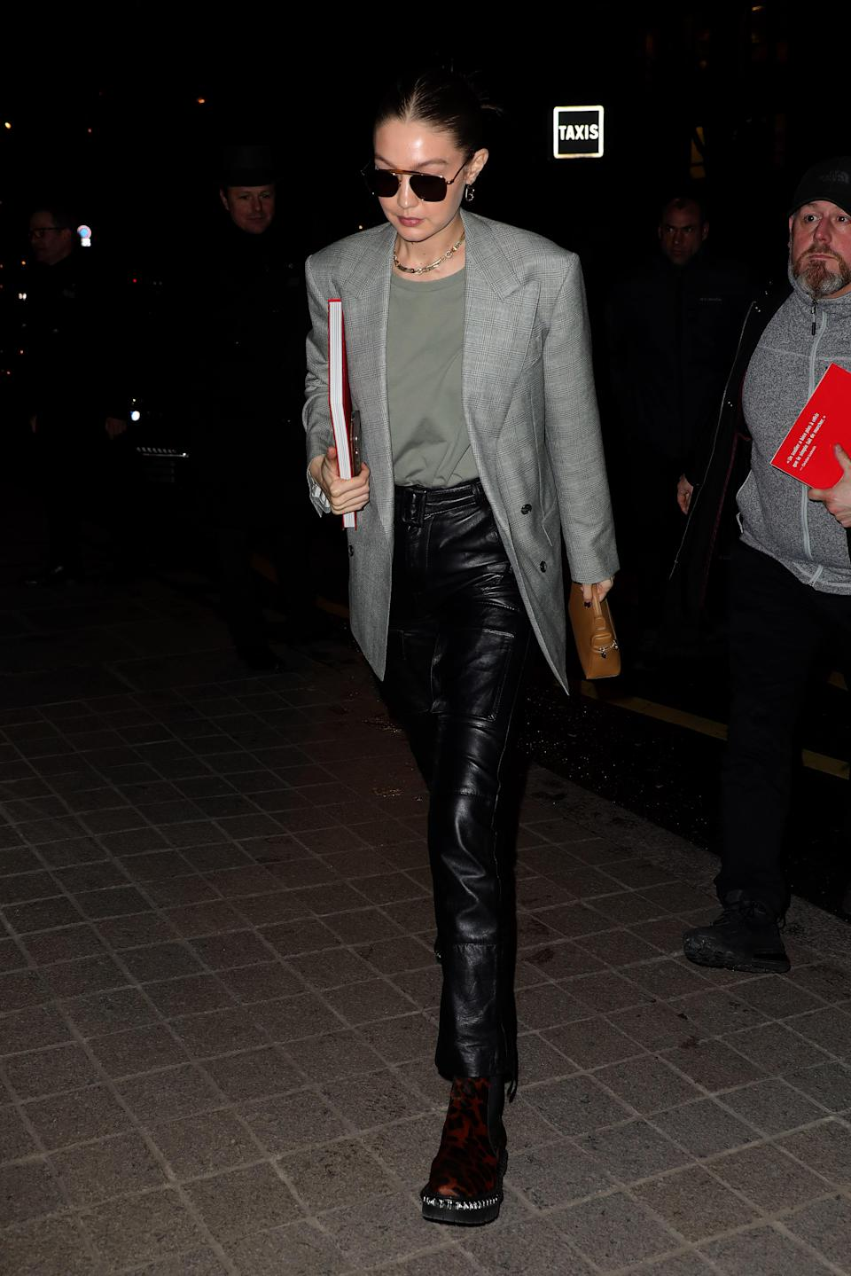You can never go wrong with a smart blazer and some pleather pants and Gigi proves so here.