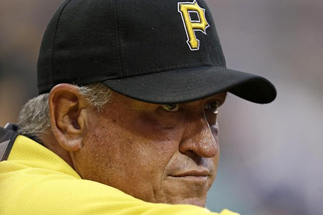 Pittsburgh Pirates manager Clint Hurdle (13) stands in the dugout during the first inning of a baseball game against the Chicago Cubs in Pittsburgh, Thursday, Sept. 12, 2013. (AP Photo/Gene J. Puskar)