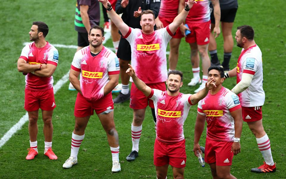 Harlequins players salute their fans after a record-breaking comeback - GETTY IMAGES