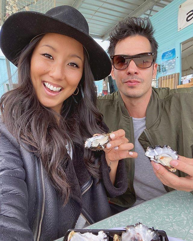 Jetstar shared a photo of podcaster Sarah Davidson and her husband Nic enjoying oysters as a subtle jab at Ruby. Photo: Instagram/Spoonful_Of_Sarah