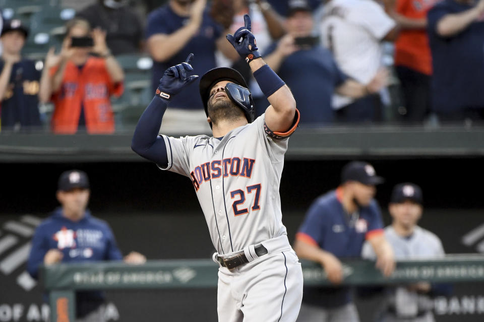 Houston Astros' Jose Altuve celebrates after hitting a two-run home run against the Baltimore Orioles in the fourth inning of a baseball game, Wednesday, June 23, 2021, in Baltimore. (AP Photo/Will Newton)