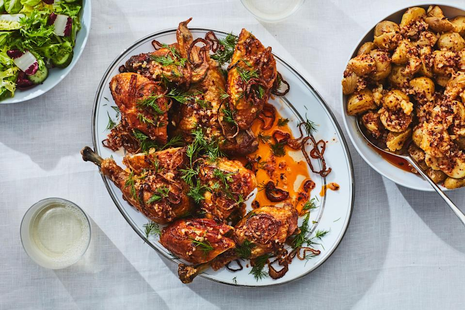 """No one will miss the brisket if your passover meal is this remarkable chicken. Quickly shallow-frying chicken halves in shallot oil yields crispy, golden-brown skin. Serve them with garlicky potatoes and top them with crunchy fried shallots and lots of fresh dill. <a href=""""https://www.epicurious.com/recipes/food/views/crispy-skin-chicken-with-dill-and-garlic-sauce?mbid=synd_yahoo_rss"""" rel=""""nofollow noopener"""" target=""""_blank"""" data-ylk=""""slk:See recipe."""" class=""""link rapid-noclick-resp"""">See recipe.</a>"""