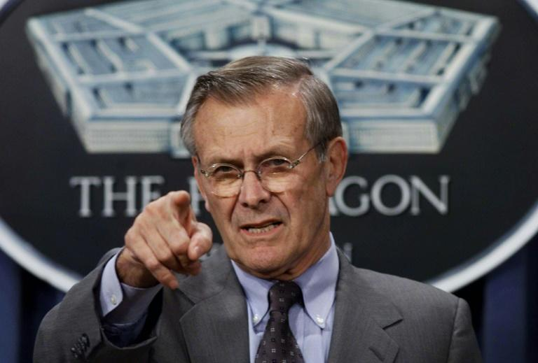 US Defense Secretary Donald Rumsfeld briefs reporters at a Pentagon in October 2001 following the US bombing raids on Afghanistan