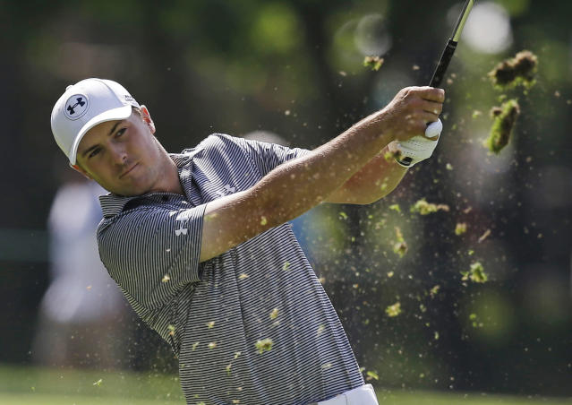 Jordan Spiethhits from the 13th fairway during the first round of the Memorial golf tournament Thursday, May 29, 2014, in Dublin, Ohio. (AP Photo/Darron Cummings)