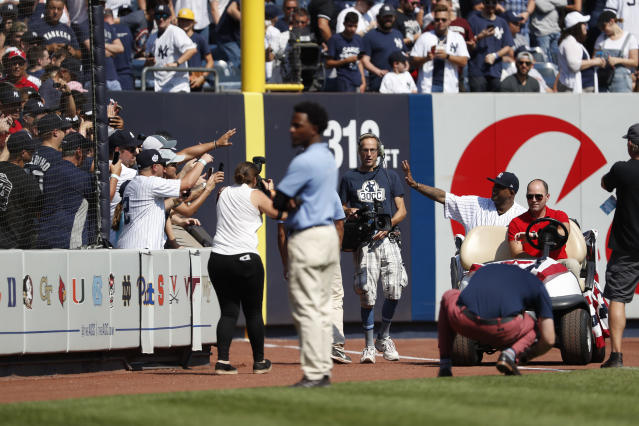 New York Yankees' CC Sabathia waves to fans as he honored before a baseball game against the Toronto Blue Jays of the team's baseball game, Sunday, Sept. 22, 2019, in New York. (AP Photo/Michael Owens)