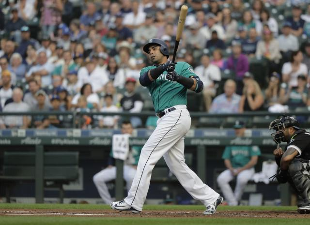 Seattle Mariners' Nelson Cruz takes a swing during a baseball game against the Chicago White Sox, Friday, July 20, 2018, in Seattle. (AP Photo/Ted S. Warren)