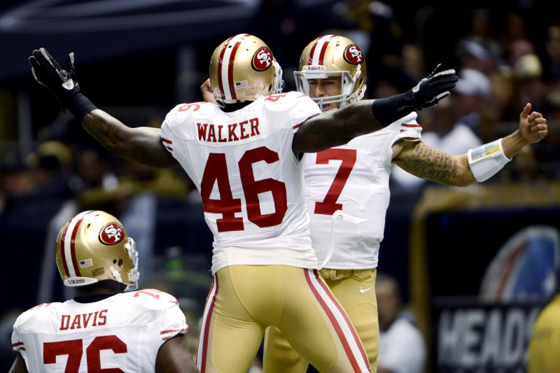 San Francisco 49ers quarterback Colin Kaepernick (7) celebrates his rushing touchdown with tight end Delanie Walker (46) in the first half of an NFL football game against the New Orleans Saints in New Orleans, Sunday, Nov. 25, 2012. The 49ers won 31-21. (AP Photo/Bill Feig)