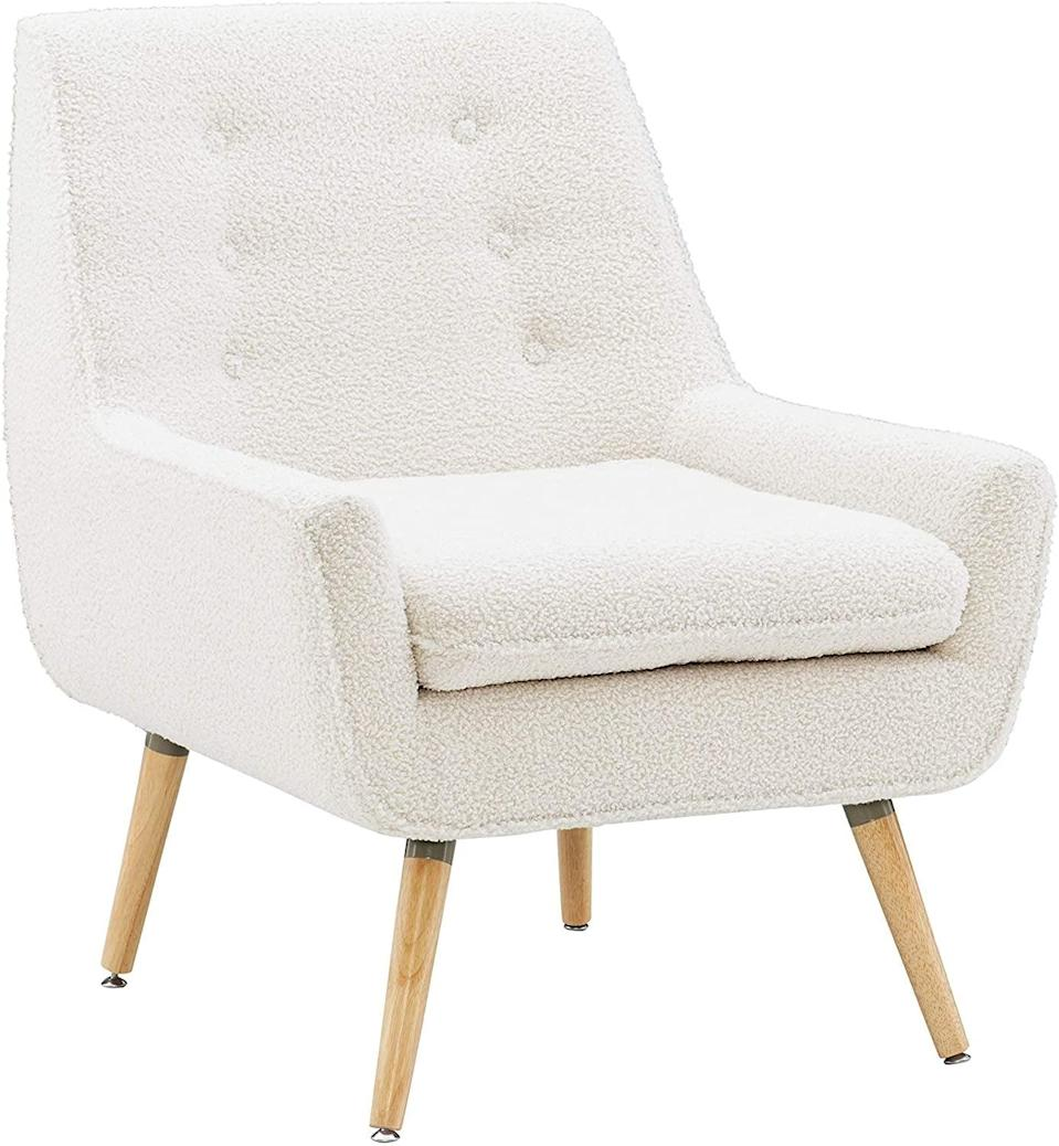 <p>This soft <span>Linon Ivory Sherpa Accent Reid Chair </span> ($233) will effortlessly make your space feel more elevated.</p>