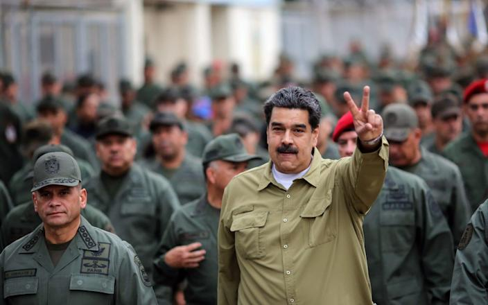 Nicolas Maduro has made a point of inspecting his troops, on a near daily basis, since Juan Guaido declared himself president - AFP