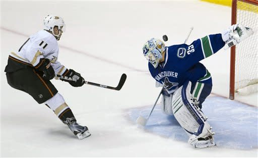 Vancouver Canucks goalie Cory Schneider (35) stops a shot by Anaheim Ducks center Saku Koivu (11) during a shootout of an NHL hockey game in Vancouver, British, Columbia, on Tuesday, April, 3, 2012. (AP Photo/The Canadian Press, Jonathan Hayward)