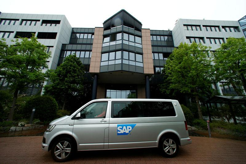 FILE PHOTO: A car with the logo of German software group SAP stands near its headquarters in Walldorf