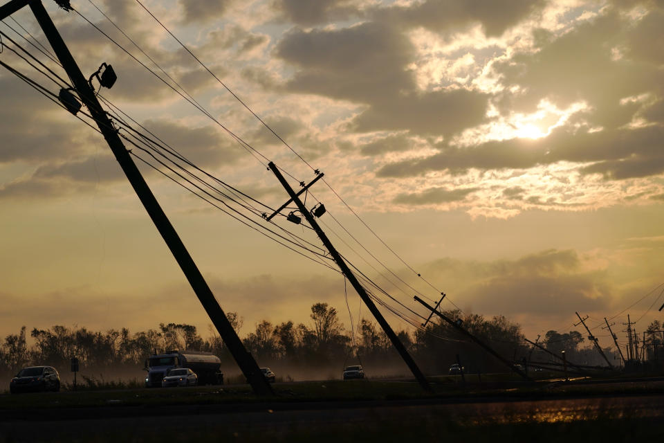 Downed power lines slump over a road in the aftermath of Hurricane Ida, Friday, Sept. 3, 2021, in Reserve, La. Power out, high voltage lines on the ground, maybe weeks until electricity is restored in some places _ it's a distressingly familiar situation for Entergy Corp., Louisiana's largest electrical utility. (AP Photo/Matt Slocum)
