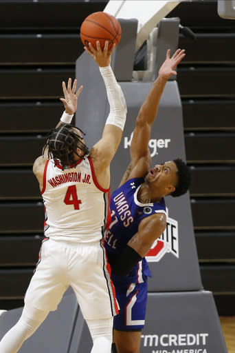 Ohio State's Duane Washington, left, shoots over UMass-Lowell's Obadiah Noel during the second half of an NCAA college basketball game Sunday, Nov. 29, 2020, in Columbus, Ohio. (AP Photo/Jay LaPrete)