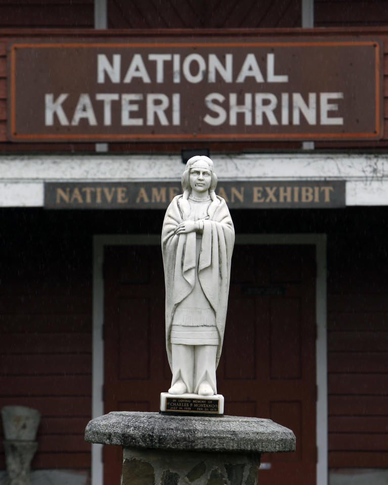 in a Wednesday, Dec. 21, 2011 photo, a statue of the Blessed Kateri Tekakwitha is seen at the National Kateri Shrine and Indian Museum in Fonda, N.Y. Tekakwitha, who will be canonized next year, was a Native American baptized in 1676 in the Mohawk Valley. She fled to a mission in Canada after being scorned and threatened in her home village near what is now the village of Fonda. (AP Photo/Mike Groll)