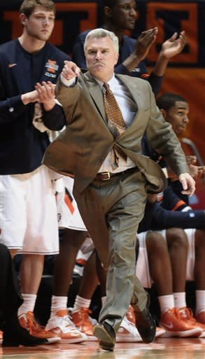 Illinois coach Bruce Weber gestures to his players in the second half of an NCAA college basketball game against Michigan in Champaign, Ill., on Thursday March 1, 2012. Michigan beat Illinois 72-61. (AP Photo/John Dixon)