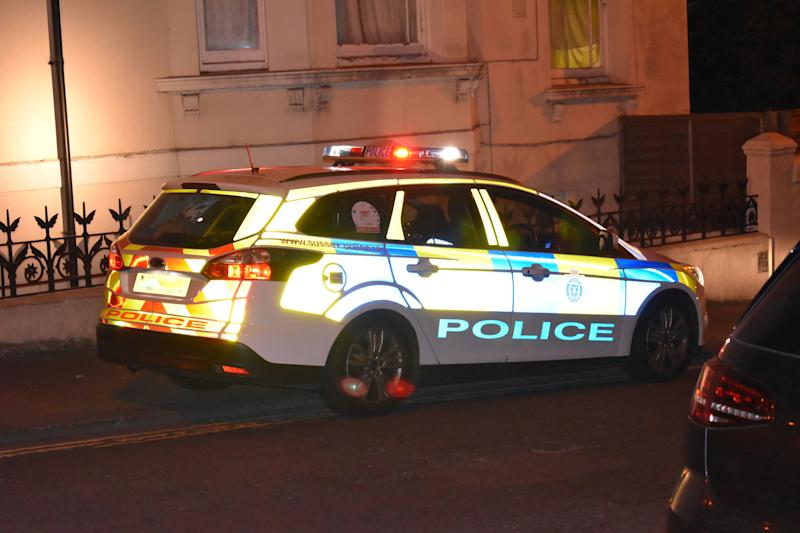 Sussex Police Car photographed at night in Hove, United Kingdom.