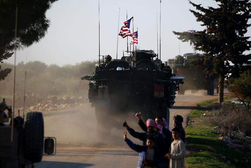 A file picture shows a convoy of US armoured vehicles passing near the village of Yalanli, near Syria's Manbij, on March 5, 2017 (AFP Photo/DELIL SOULEIMAN)