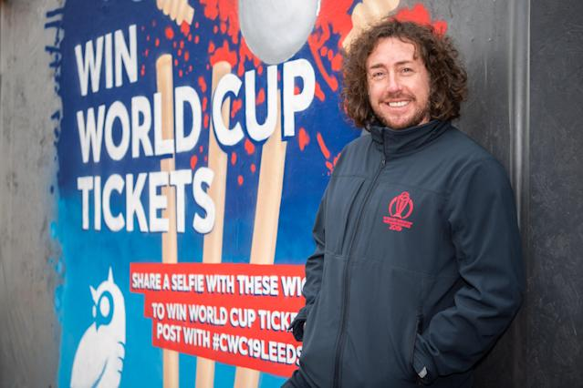 Sidebottom with the 2019 Cricket World Cup mural in Leeds, England