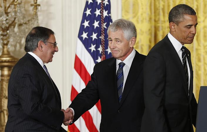 """FILE - In this Jan. 7, 2013 file photo, current Defense Secretary Leon Panetta shakes hands with former Nebraska Sen. Chuck Hagel, center, as President Barack Obama moves to the podium during a new conference in the East Room of the White House in Washington. Defense Secretary hopeful, Hagel has called the U.S. embargo against Cuba """"nonsensical"""" and anachronistic. The nominee for U.S. Secretary of State, Sen. John Kerry once held up millions in funding for secretive USAID democracy-building programs in Cuba. With the men poised to occupy two of the most important positions in Obama's new Cabinet, observers on both sides of the Florida Straits say the time could be ripe for a reboot in relations between the Cold War enemies - despite major obstacles still in the way. (AP Photo/Carolyn Kaster, File)"""