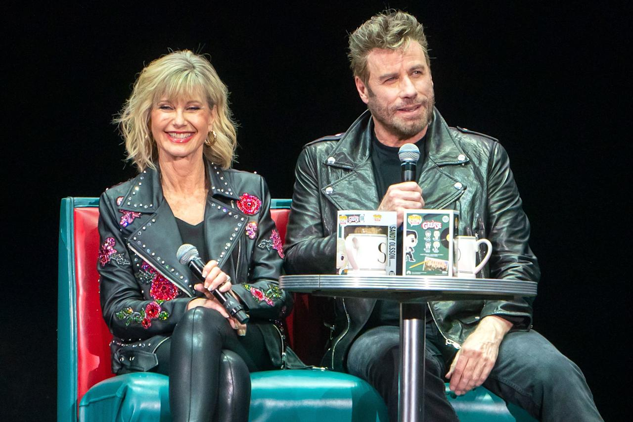 John Travolta and Olivia Newton-John are reunited in West Palm Beach, Florida, where they dressed up as their <em>Grease</em> characters Danny Zuko and Sandy Olsson for a movie sing-along event on Friday.
