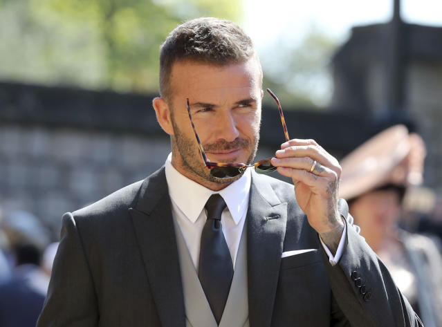 David Beckham arrives at St. George's Chapel at Windsor Castle for the wedding of Meghan Markle and Prince Harry. (Associated Press)