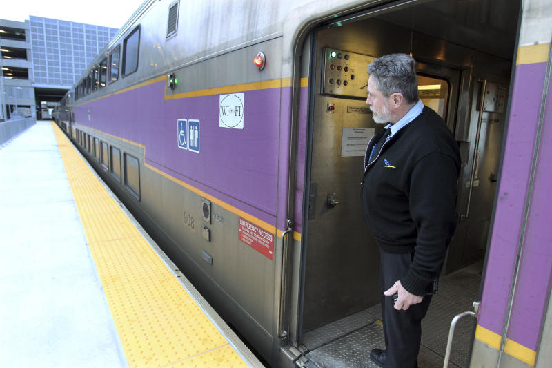FILE - In this April 1, 2011 file photo, MBTA conductor James Moriarty looks out as a train leaves the T.F. Green Airport station in Warwick, R.I., heading to Boston. More passengers are using the commuter rail line between Providence and Rhode Island's main airport, transportation officials reported Friday, April 6, 2012, but not as many as was hoped when the trains started rolling in late 2010. The MBTA said ridership statistics 14 months after the service began show an average of 149 people take the train to the airport each weekday, and 177 people ride outbound. (AP Photo/Stew Milne, File)