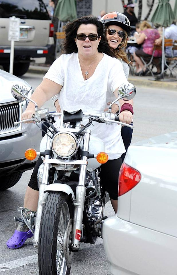 Rosie O'Donnell -- who recently started a gig as a talk show host on Oprah Winfrey's new network -- took girlfriend Michelle Rounds for a motorcycle ride through South Beach, Miami, over Thanksgiving weekend. With just one helmet between them, Rosie did the chivalrous thing and made sure her better half's head was protected. Rosie wasn't breaking the law by not wearing a helmet, since the state of Florida doesn't require that adult motorcyclists wear one, but it still sounds kind of dangerous to us!  (11/25/2011)