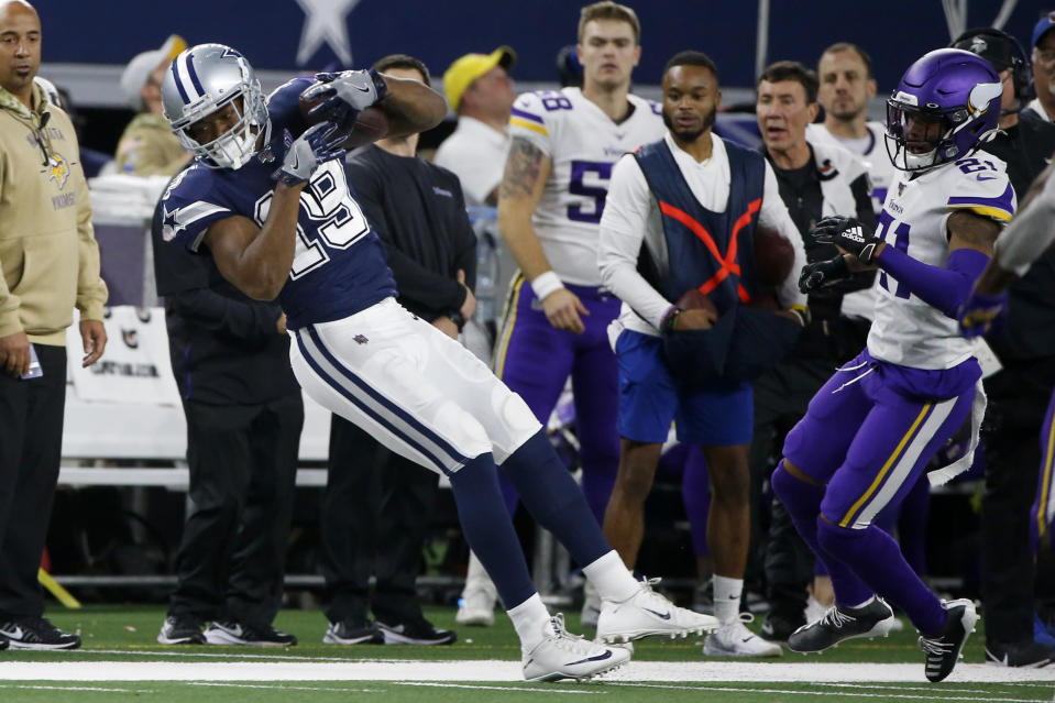 Dallas Cowboys wide receiver Amari Cooper (19) catches a pass along the sideline as Minnesota Vikings' Mike Hughes (21) defends during the first half of an NFL football game in Arlington, Texas, Sunday, Nov. 10, 2019. (AP Photo/Ron Jenkins)