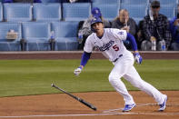 Los Angeles Dodgers' Corey Seager drops his bat as he hits a solo home run during the first inning of a baseball game against the Colorado Rockies Tuesday, April 13, 2021, in Los Angeles. (AP Photo/Mark J. Terrill)