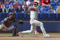 Philadelphia Phillies' Bryce Harper strikes in front of Toronto Blue Jays catcher Danny Jansen during the ninth inning of a baseball game Sunday, May 16, 2021, in Dunedin, Fla. (AP Photo/Mike Carlson)