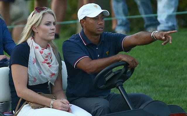 DUBLIN, OH - OCTOBER 03: Skiier Lindsey Vonn waits with Tiger Woods during the Day One Four-Ball Matches at the Muirfield Village Golf Club on October 3, 2013 in Dublin, Ohio. (Photo by Andy Lyons/Getty Images)
