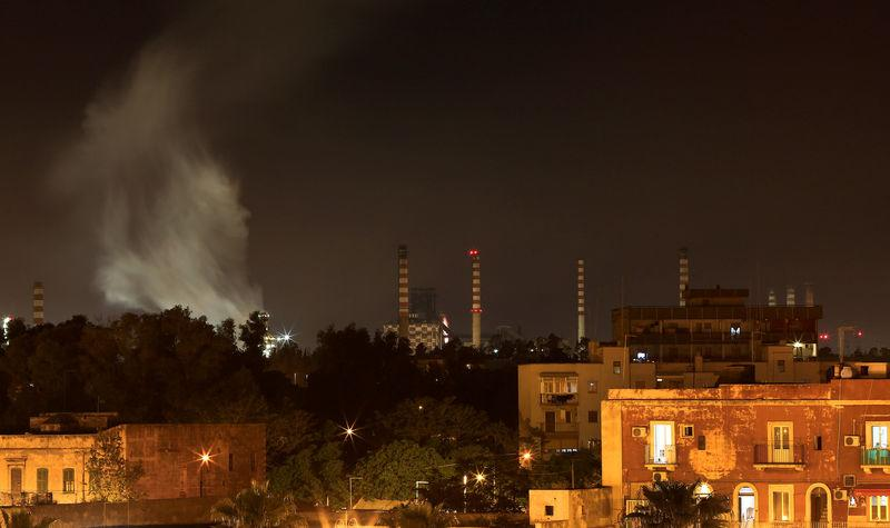 FILE PHOTO: The ILVA steel plant is seen next to the Tamburi district, in Taranto