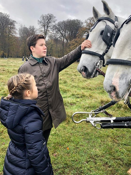 <p>November 2019: The princess shared this snap of Christian, 14, and eight-year-old Josephine with carriage horses at the annual Hubertus Hunt. Photo: Instagram/detdanskekongehus.</p>
