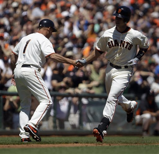 San Francisco Giants' Buster Posey, right, is congratulated by third base coach Tim Flannery after hitting a two-run home run off Colorado Rockies' Drew Pomeranz in the third inning of a baseball game on Saturday, Aug. 11, 2012, in San Francisco. (AP Photo/Ben Margot)