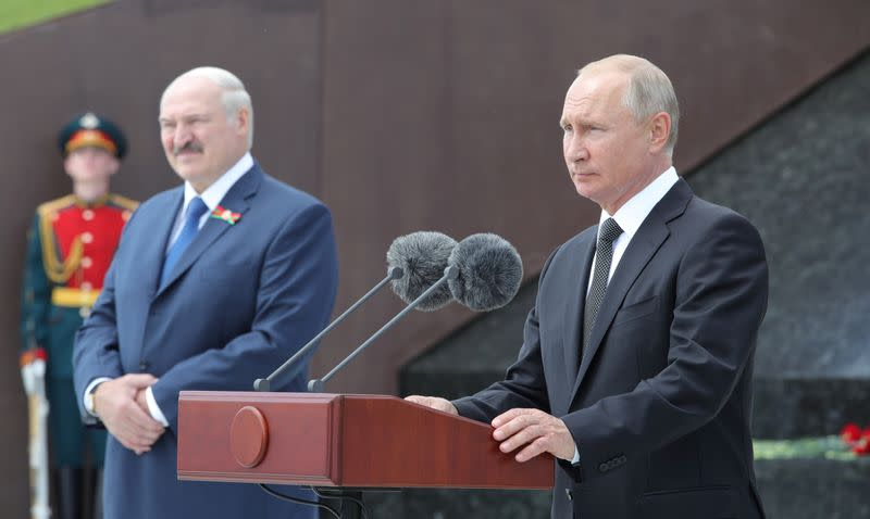 FILE PHOTO: Russian President Putin and his Belarusian counterpart Lukashenko attend a ceremony unveiling the Memorial to the Soviet Soldier near Rzhev in Tver Region