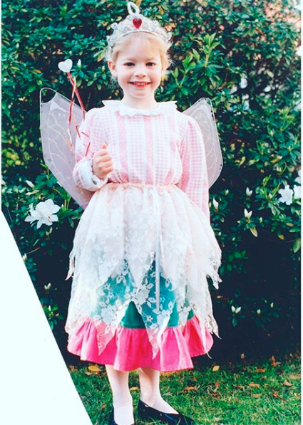 Emma Watkins as a child in a fairy costume