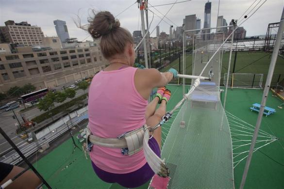 Student takes off at Trapeze School New York June 24, 2012.