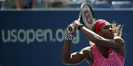 Serena Williams of the U.S. hits a return to compatriot Vania King at the 2014 U.S. Open tennis tournament in New York
