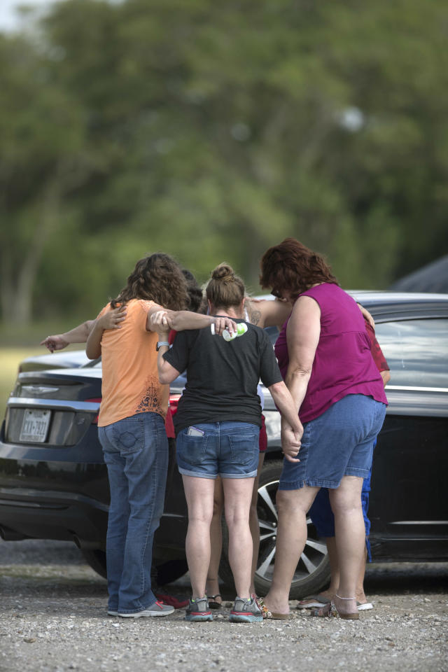 <p>Parents of Santa Fe High School students join in prayer at the parking lot of the Arcadia First Baptist Christian School accompanied by residents after a shooter open fired at the high school, Friday, May 18, 2018, in Santa Fe, Texas. (Photo: Marie D. De Jesus/Houston Chronicle via AP) </p>