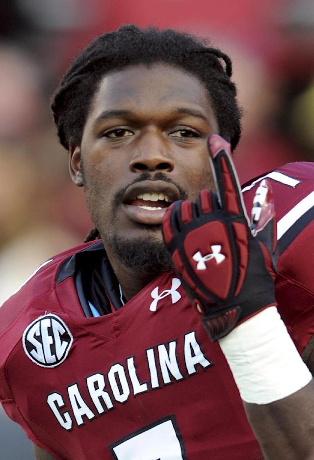 FILE - In this Sept. 14, 2013, file photo, South Carolina defensive end Jadeveon Clowney gestures as he stretches before an NCAA college football game against Vanderbilt in Columbia, S.C. Clowney finished last season with 11 1/2 tackles for loss and three sacks after getting 23 1/2 and 13 in 2012. He is a top prospect in the upcoming NFL draft. (AP Photo/Stephen Morton, File)