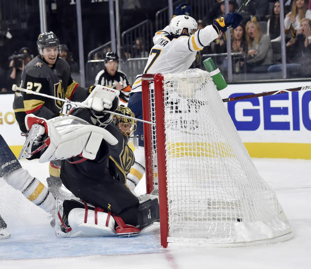 Vegas Golden Knights goaltender Marc-Andre Fleury (29) watches as the puck lands in the goal after a shot by Buffalo Sabres center Vladimir Sobotka (17) during the third period of an NHL hockey game, Tuesday, Oct. 16, 2018, in Las Vegas. (AP Photo/David Becker)